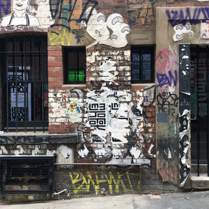 Savouring street art in Duckboard Place, Melbourne