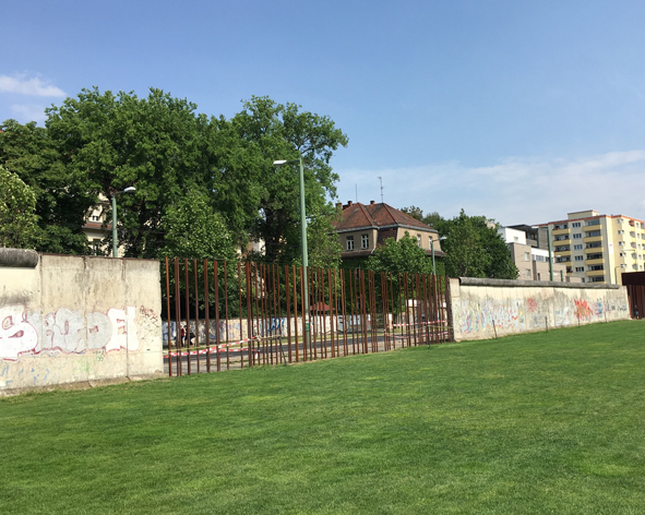 A section of the Berlin Wall standing in the Berlin Wall Memorial.